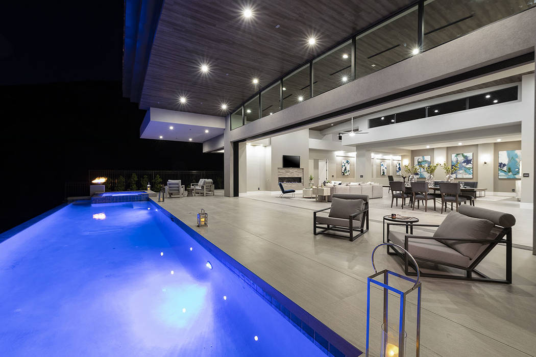 The pool runs along the back patio. (Synergy|Sotheby's International Realty)