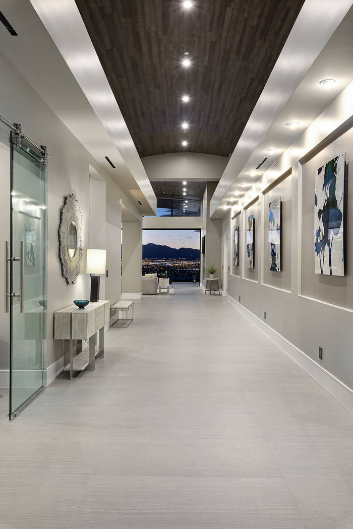 The hallway is designed for art. (Synergy|Sotheby's International Realty)
