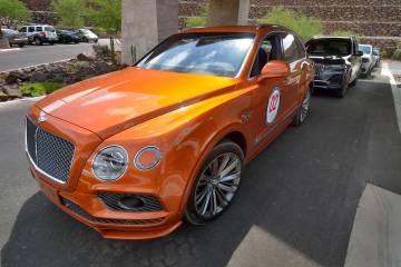 A 2019 Bentley Bentayga Speed is in a line of luxury vehicles during the Robb Report Dream Mach ...
