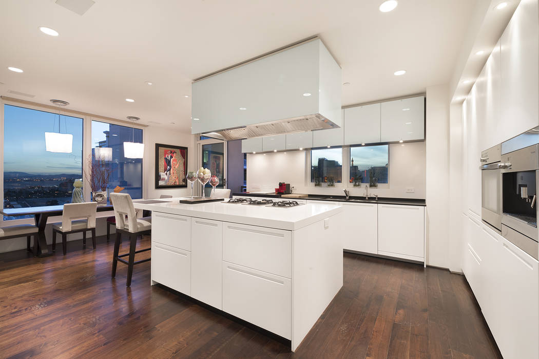 This Park Towers condo features a white kitchen with a sleek, modern design. (Ivan Sher Group)