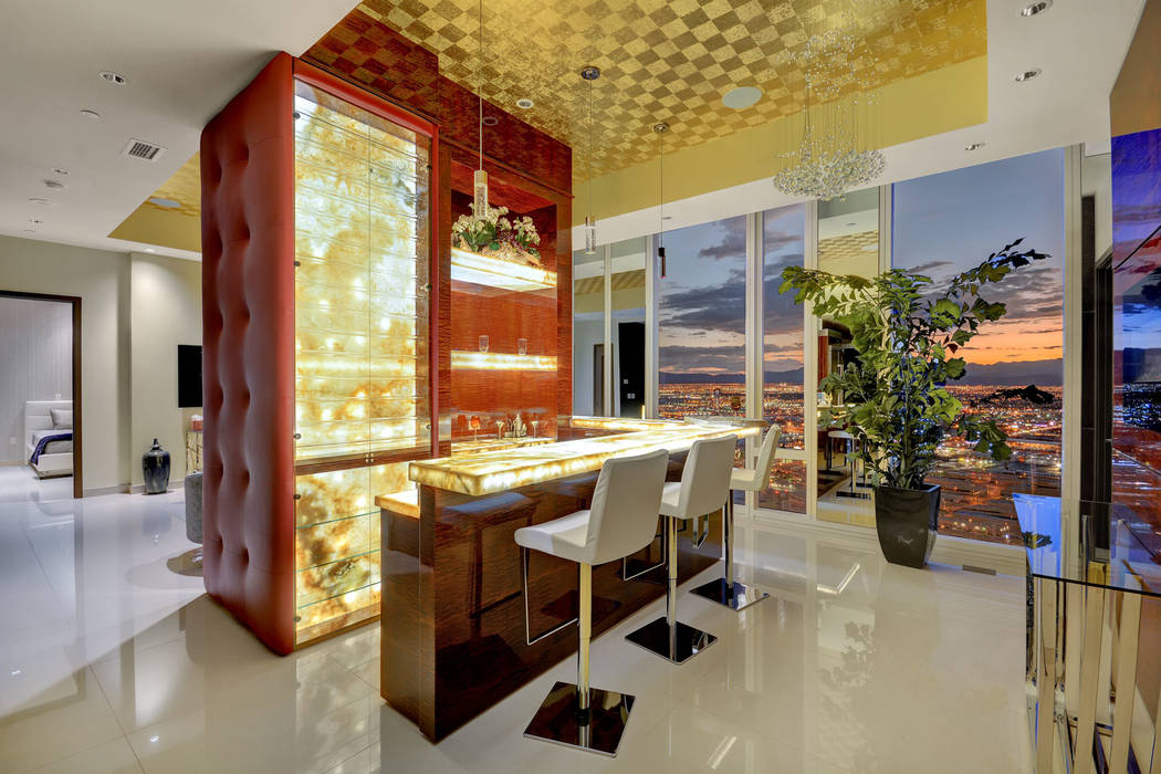 The Waldorf Astoria Presidential Penthouse features a unique translucent Onyx bar. (Award Realty)