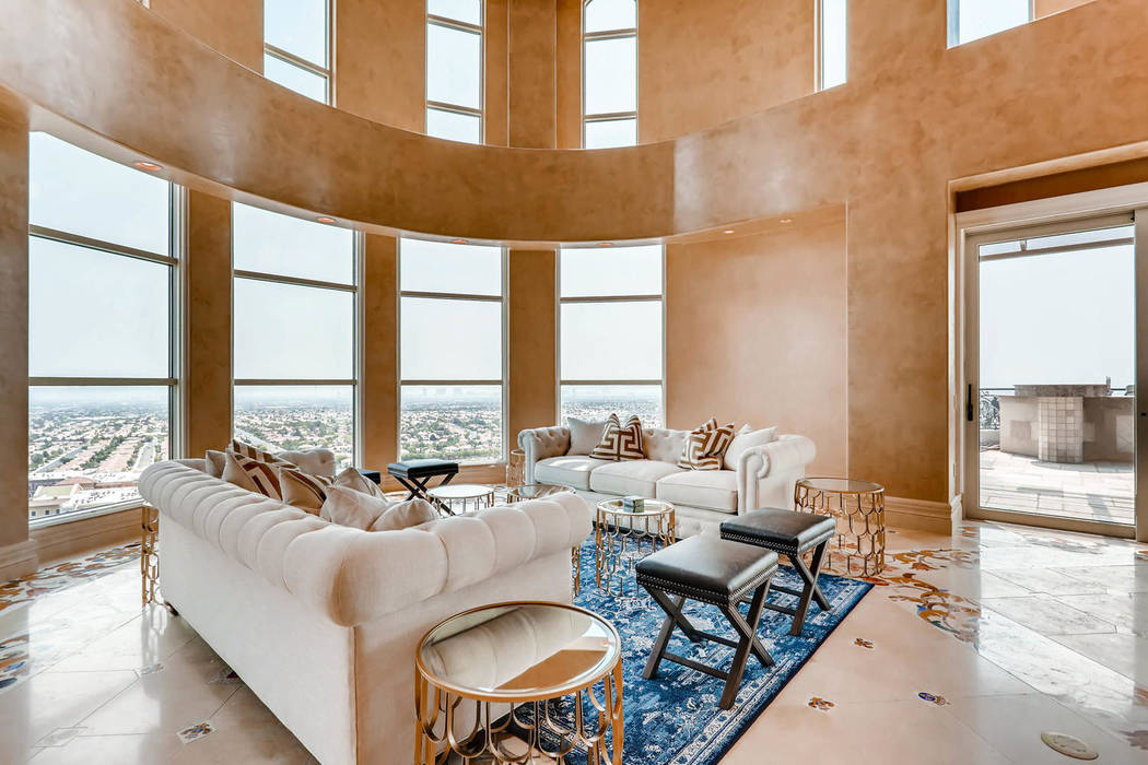 The living room has sweeping views of the Las Vegas Strip. (Char Luxury Real Estate)