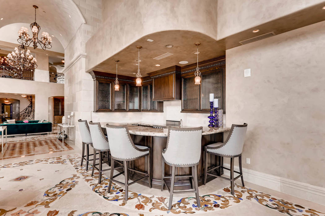 A bar is off the entrance. (Char Luxury Real Estate)