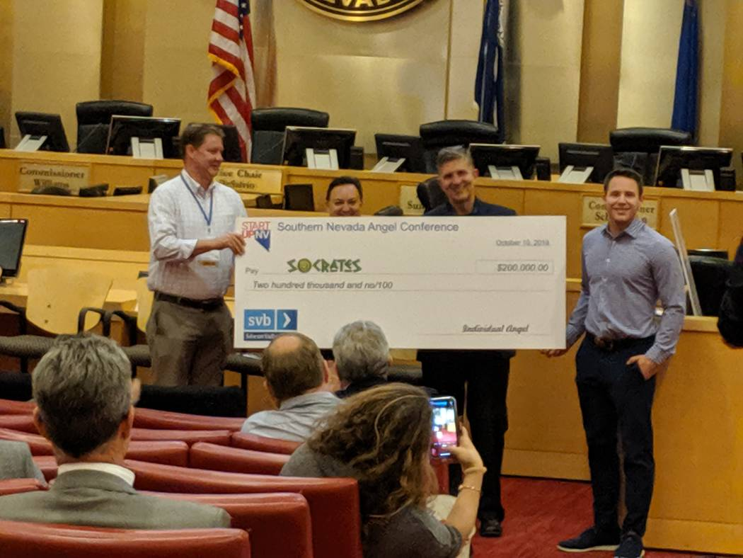 Socrates founder Brian Rosenberg receives check representing $20,000 at The Oct. 10 StartUpNV c ...