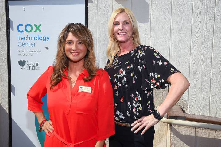 From left, Linda Perez, The Shade Tree, with Kim Salinas, Cox Business.