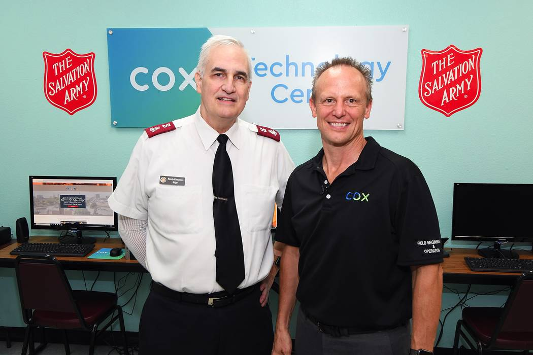 From left, Major Randy Kinnamon, Salvation Army, and David Diers, Cox Communications.