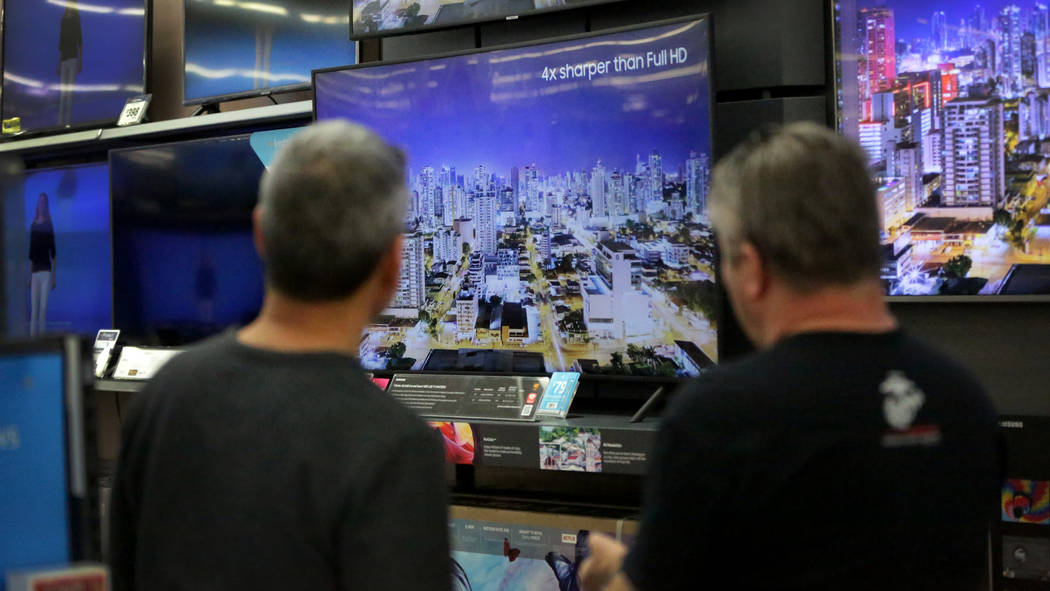 Brothers Robert, left, and Joe Seeburger check out high-resolution LED TVs at Walmart on Nov. 2 ...