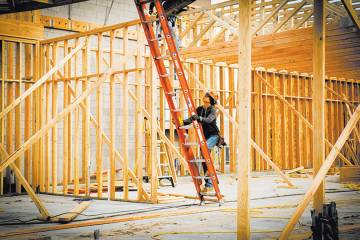 This file photo shows a worker at a new-home construction site. Local homebuilders just posted ...