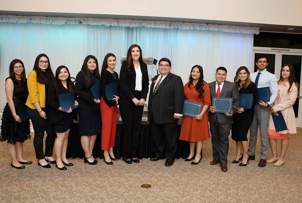 Las Vegas Latino Bar Association board members Claudia Aguayo and Romeo Perez, center, are pict ...