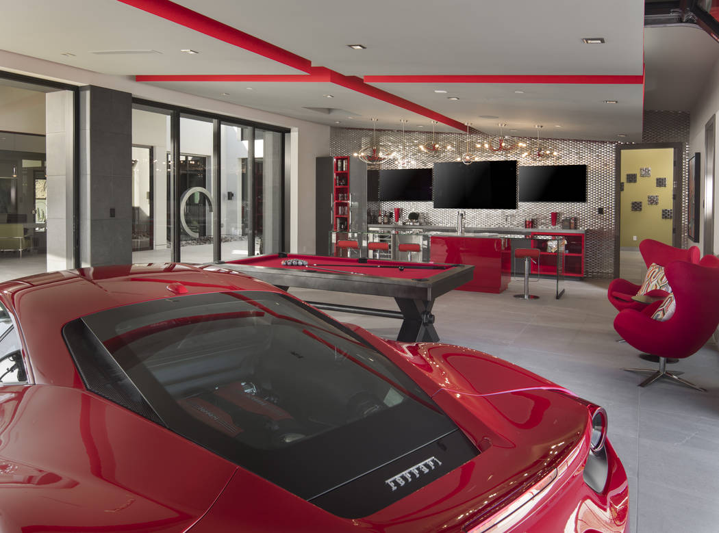 The 2019 New American Home has a garage that doubles as an air-conditioned man cave with a pool ...