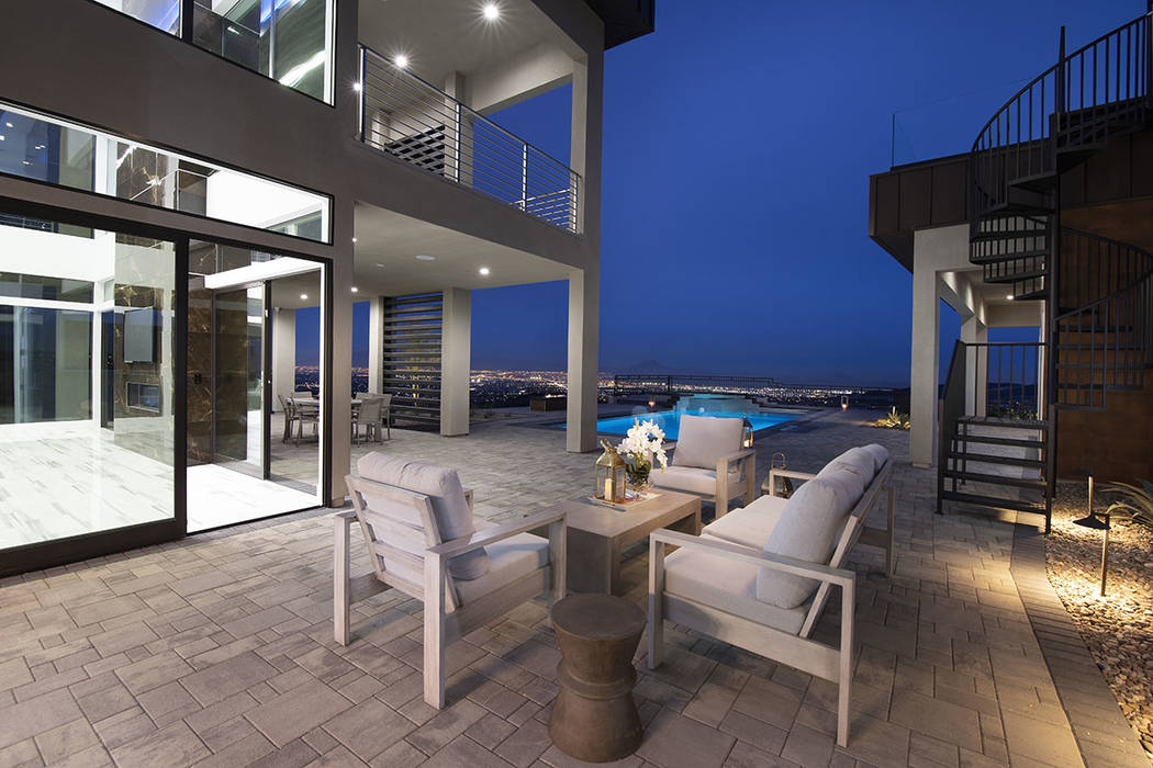 A sitting area is near the pool. (Synergy Sotheby's International Realty)