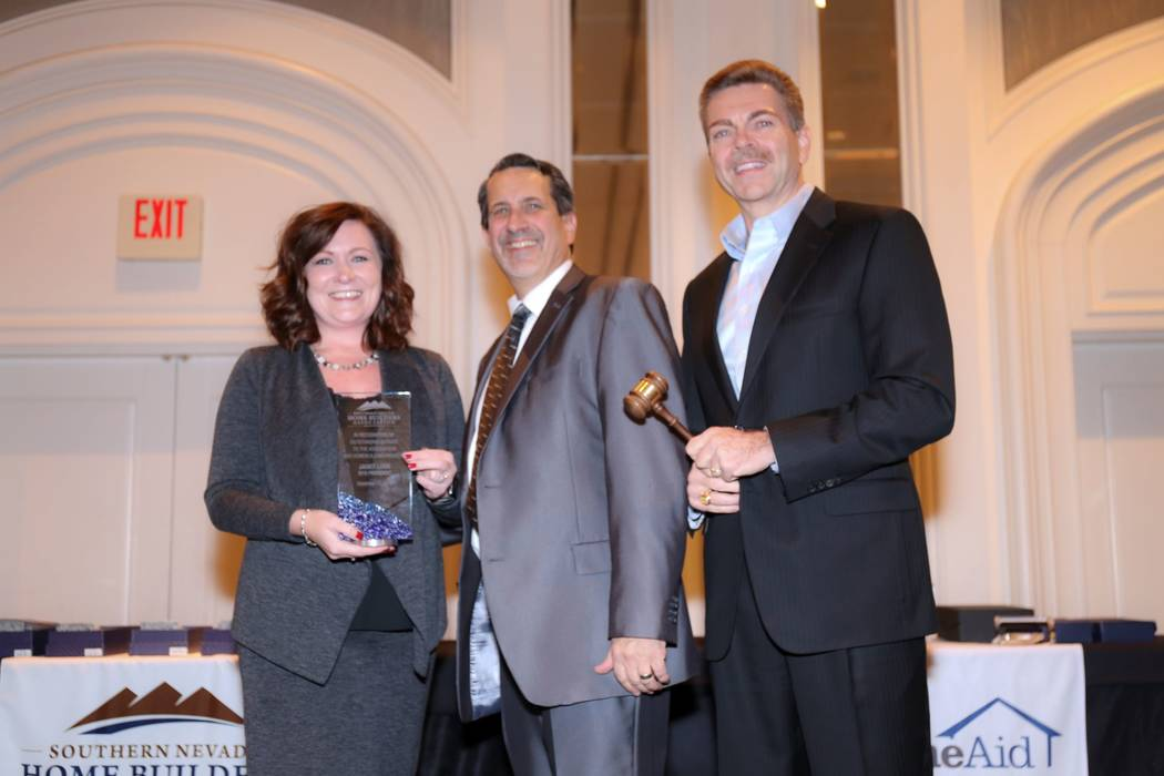 Brian Walsh, right, of Howard Hughes Corp. was appointed as the new SNHBA board president. Jane ...