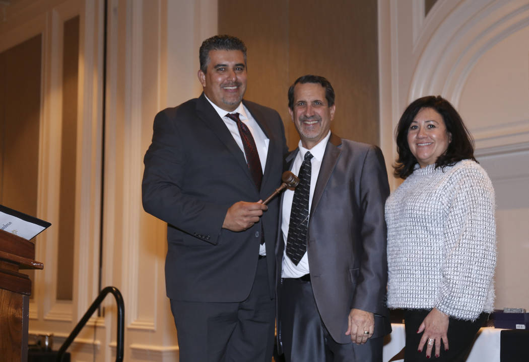 Carlos Zuluagua, left, of Pardee Homes has been named board president of HomeAid Southern Nevad ...