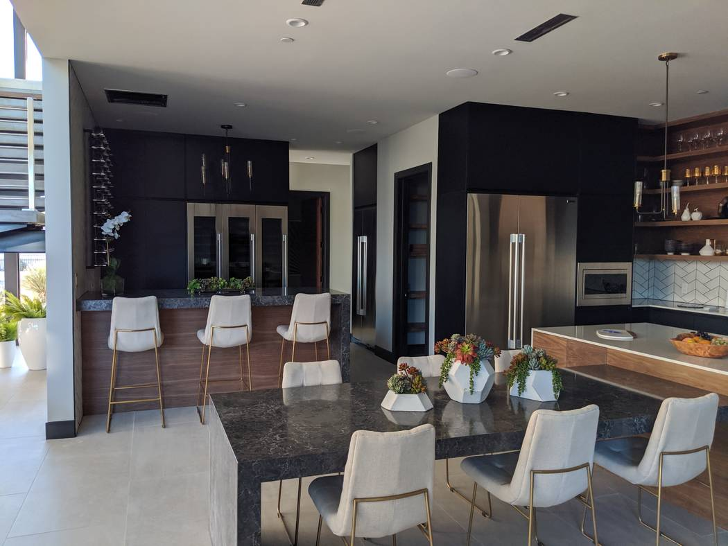 The home's new kitchen is sleek and modern. (Element Building Co.)