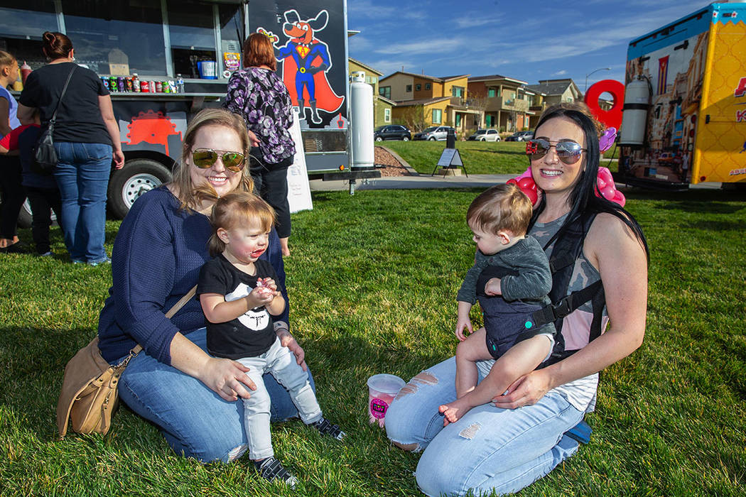 Families enjoyed the food trucks and other activities at Cadence's fifth anniversary party in m ...
