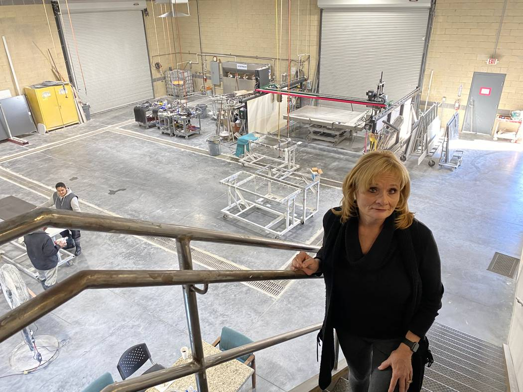 Judy Beckowitz, president and owner of American Countertops & Floors, stands in her new 5,557-s ...