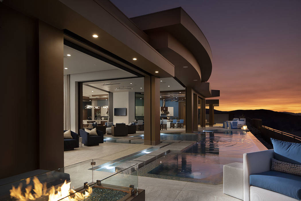 Sun West Custom Homes built the house to include indoor/outdoor living features. (Jeffrey A. Da ...
