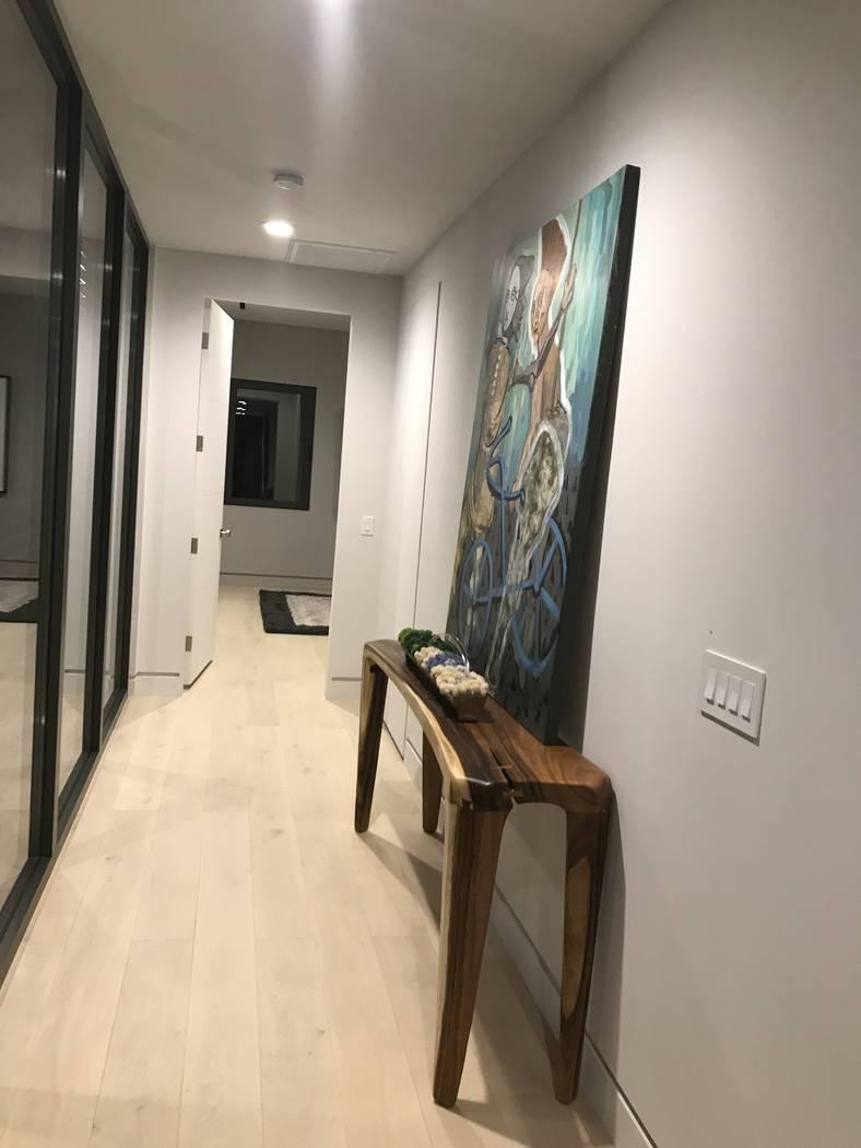 The hallway features artwork. (Kimberly Joi McDonald)