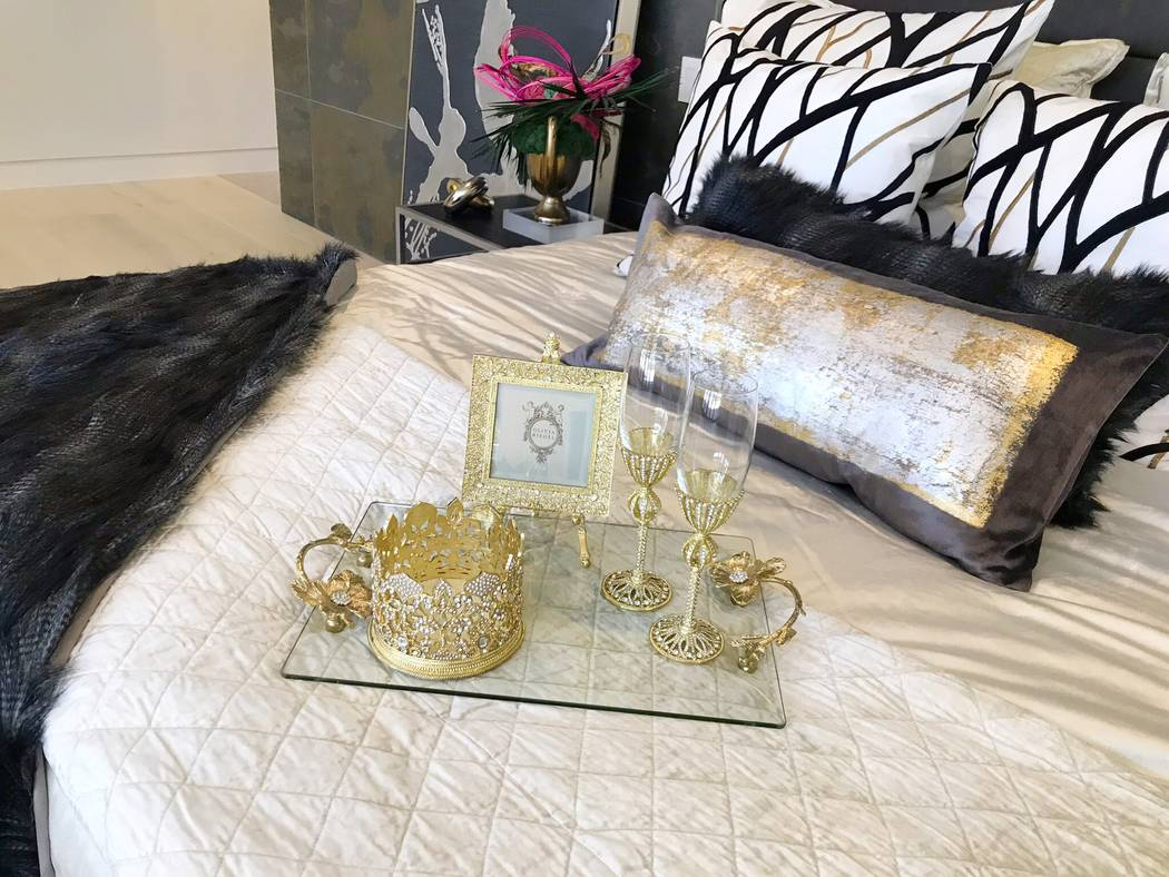 The bedrooms were carefully staged for the World Market Center winter home furnishings' show. ...