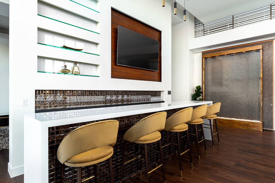 The bar is a centerpiece of the high-rise penthouse. (Turnkey Pads)