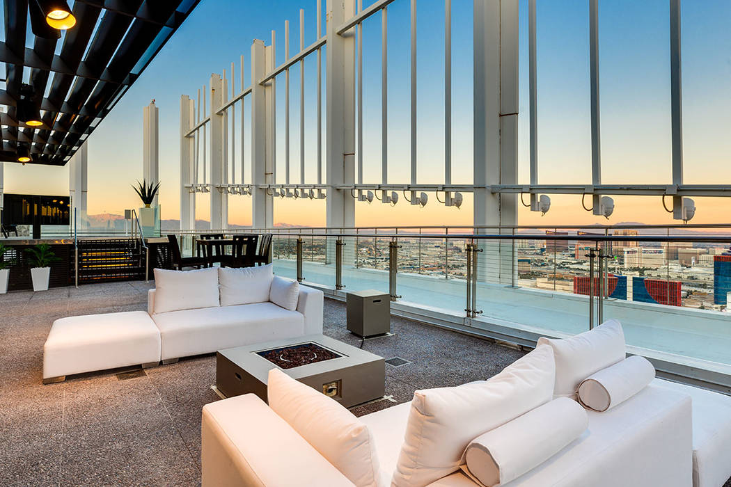 The Palms unit has about 13,000 square feet of outdoor space with a perimeter terrace that prov ...