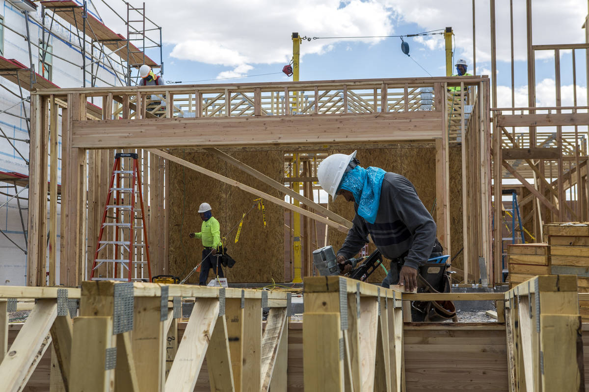 Workers build a Century Communities home in southwest Las Vegas in 2017. The homebuilding indus ...