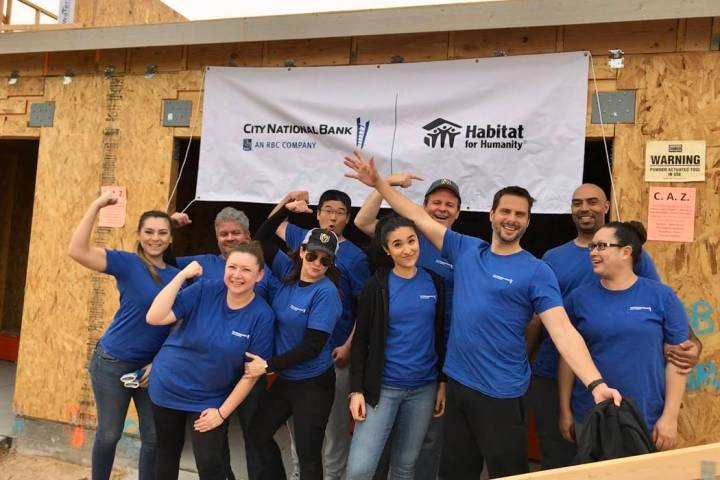 City National Bank colleagues take part in Habitat for Humanity Las Vegas' project with two hom ...