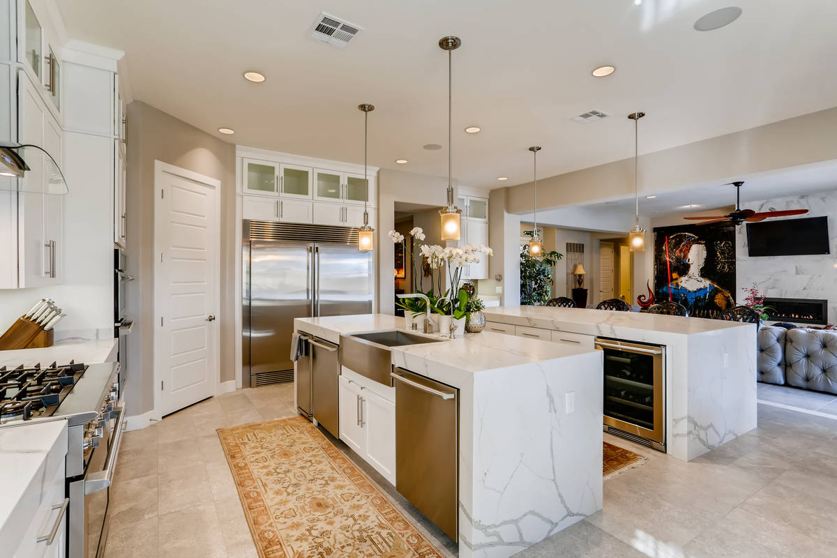 The kitchen has two large islands with plenty of room for seating and upgraded appliances. (Rea ...