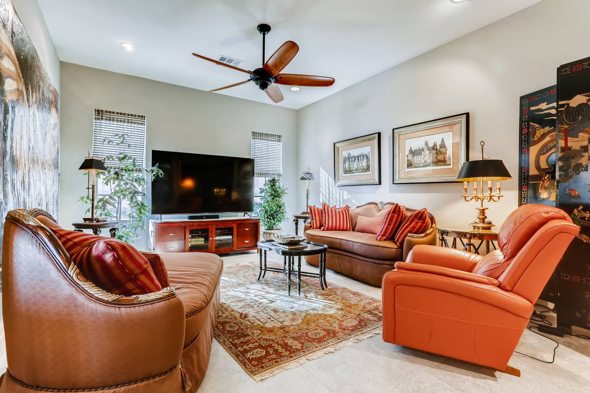 The Southern Highlands home features a family room that provides an intimate setting. (Realty O ...