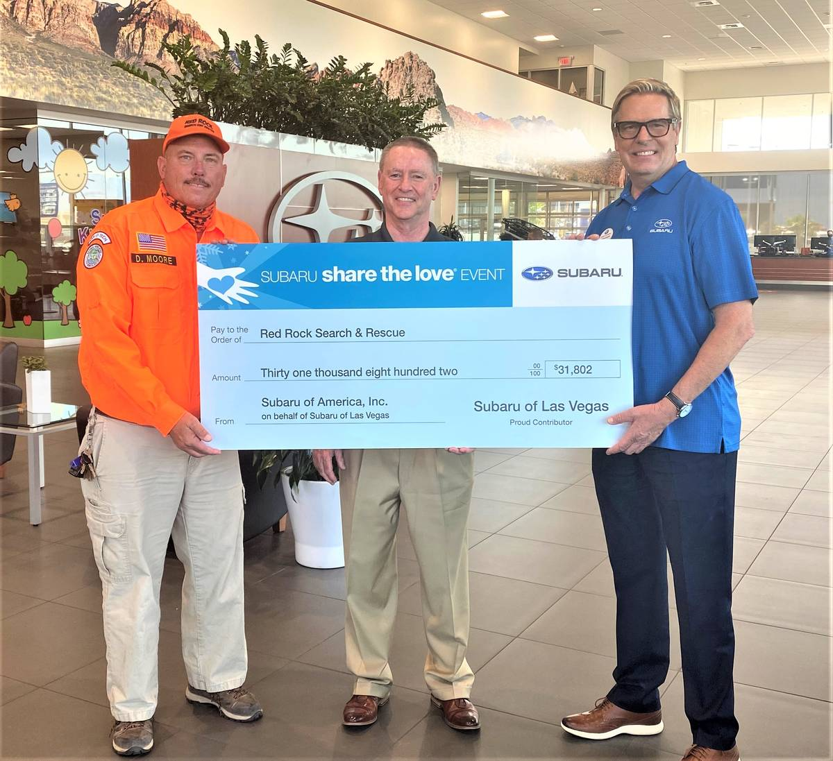 Subaru of America Inc. and Findlay's Subaru of Las Vegas presented a check for $31,802 to Red ...