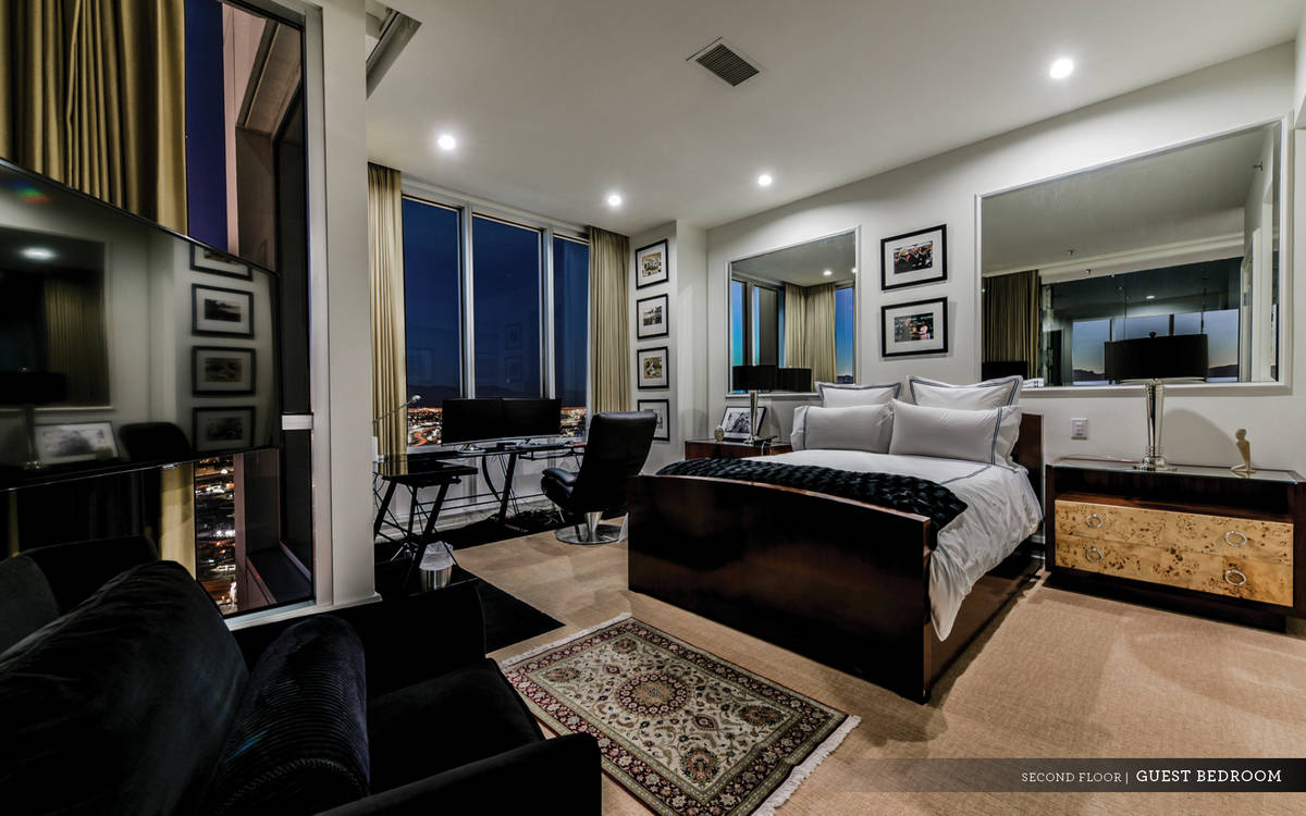 A double-door entry leads to the private second-level master suite with a refreshment bar. With ...