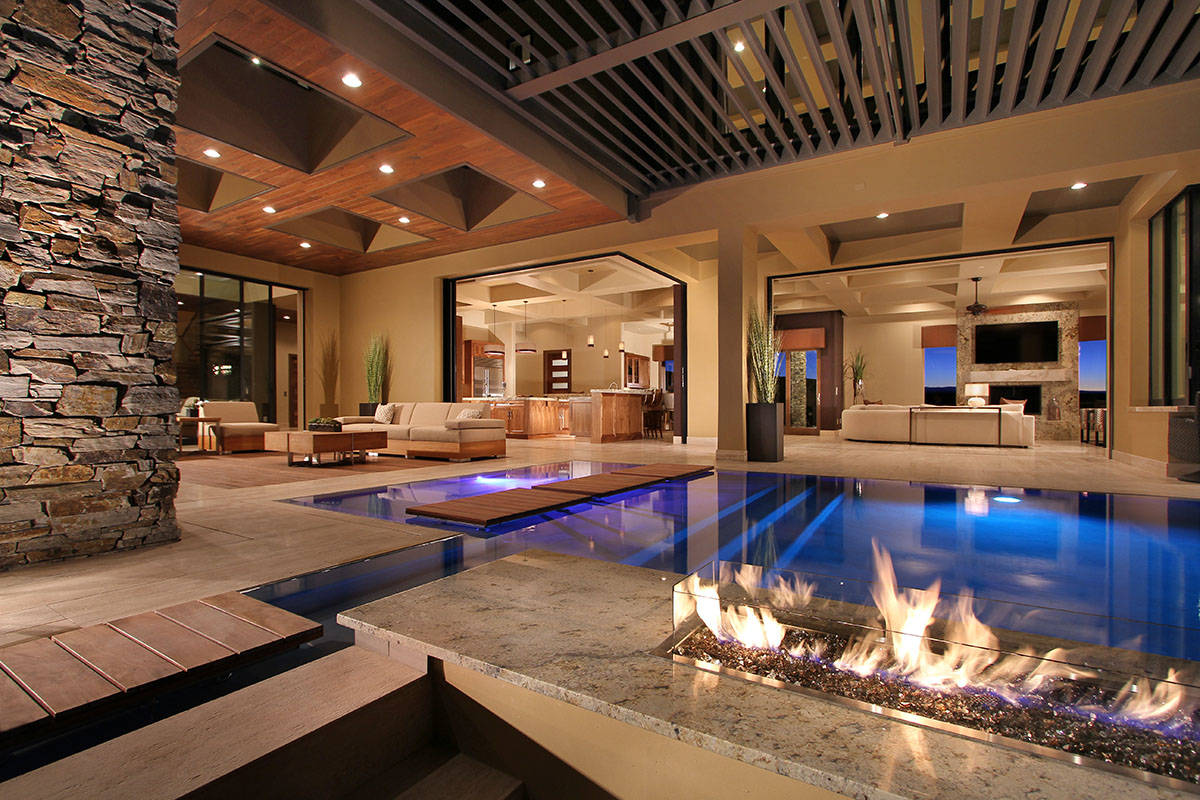 This MacDonald Highlands mansion features a pool that flows up to indoor/outdoor living spaces. ...