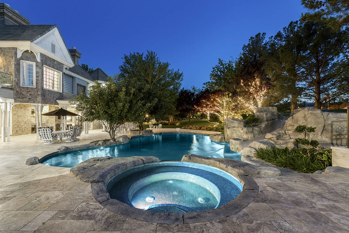 The Queensridge mansion has mature landscaping and pool and spa. (Tom Love Group)