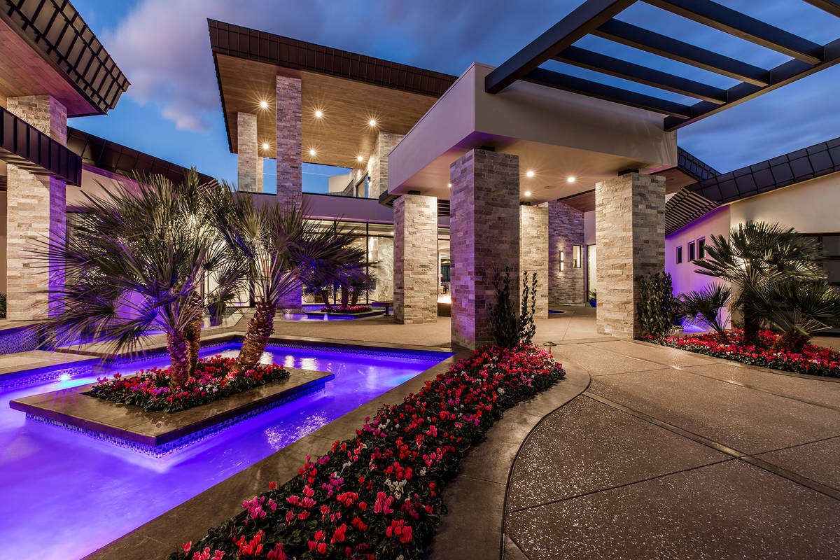 The Seven Hills has a theater, wine room and casita in the front of the home. (Ivan Sher Group)