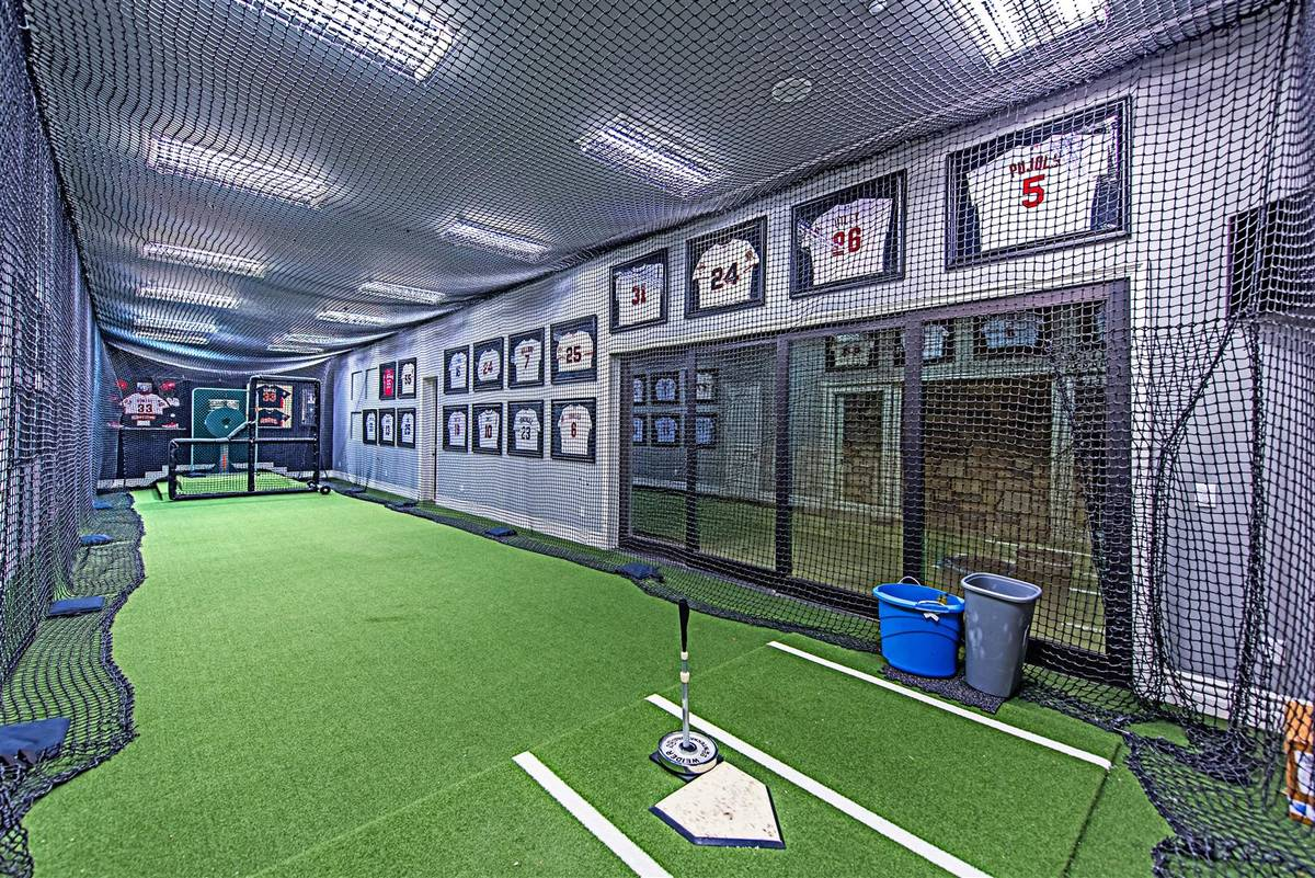 Former Major League Baseball player Aaron Rowand built his 10,948-square-foot home with an indo ...