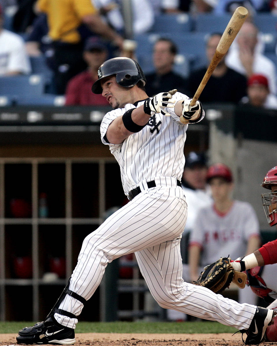 This file photo shows Chicago White Sox' Aaron Rowand hitting a home run on June 1, 2005 in Chi ...