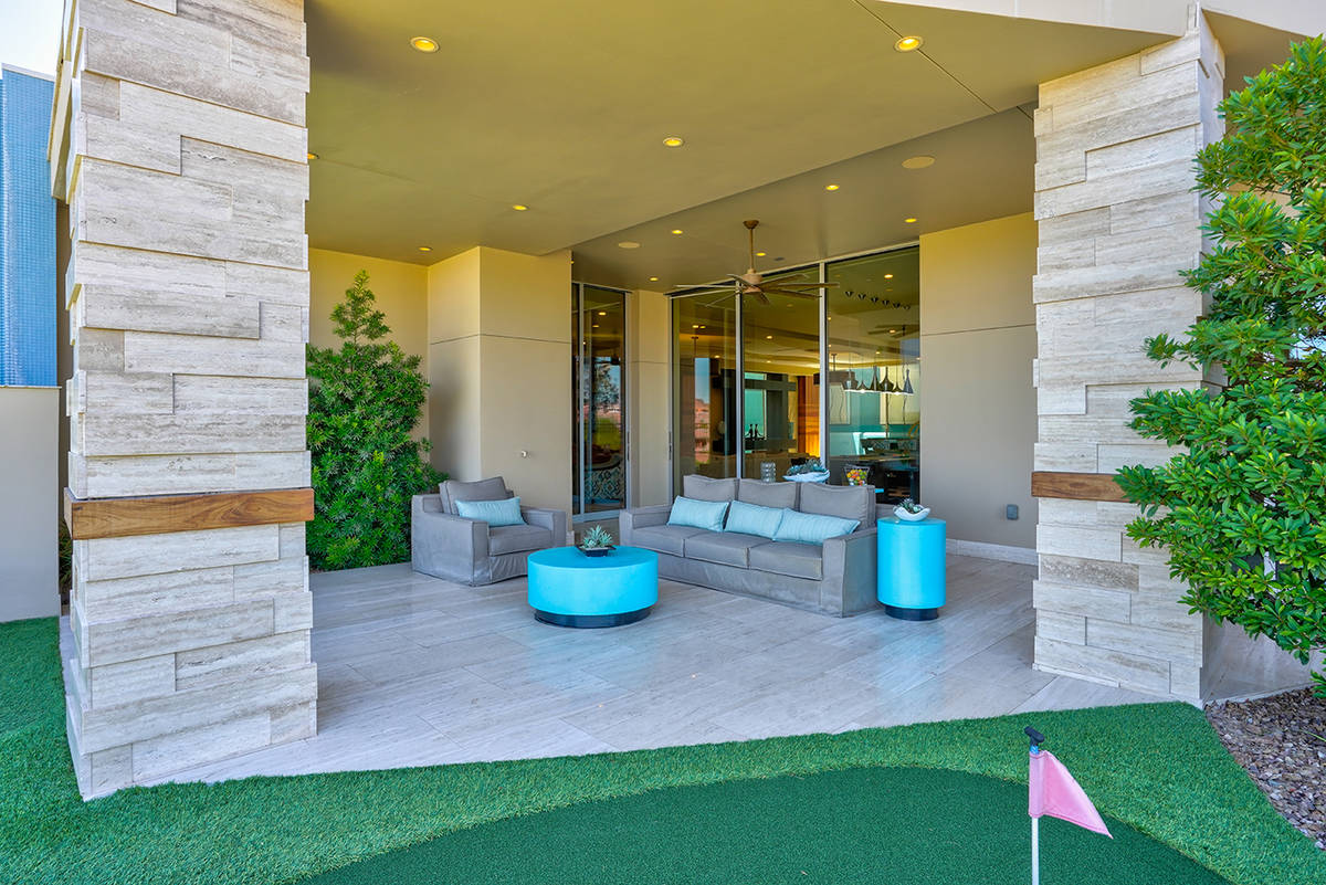 Water features surround the house, which was Sun West Custom Homes' showcase in MacDonald Highl ...