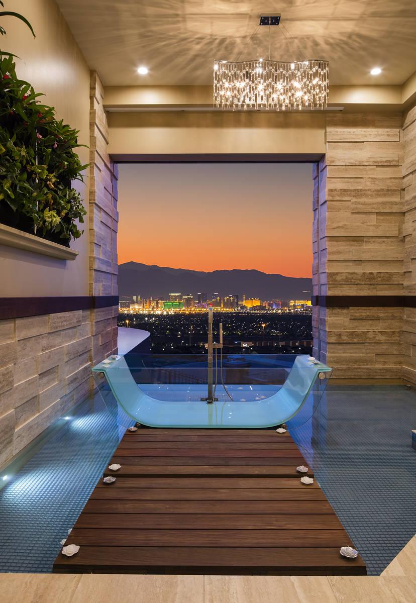 The Henderson home's master bedroom has a unique bath that has views of the Las Vegas Strip. (S ...