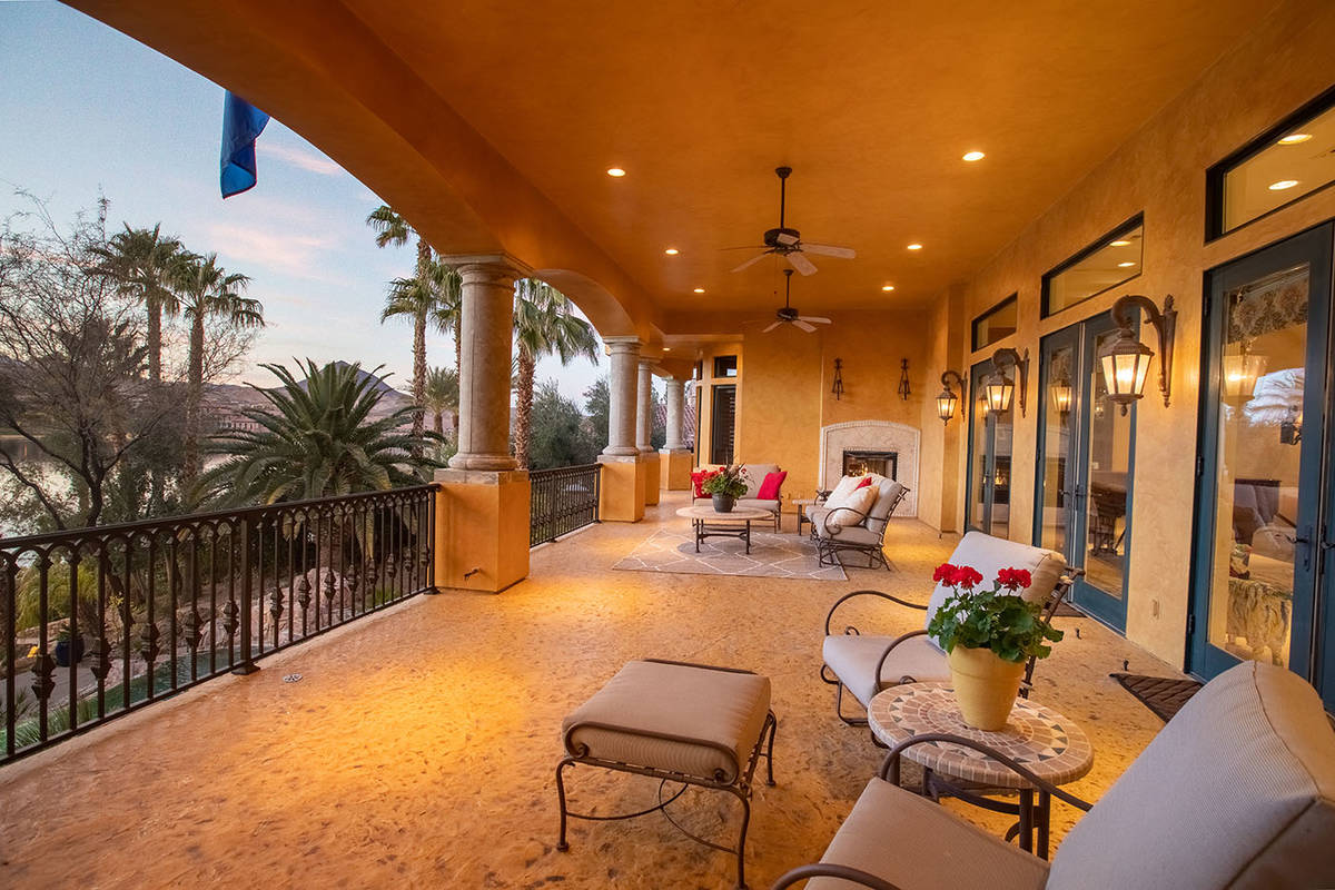 The Lake Las Vegas home was designed after the owner's love of Italy. Its main level has a balc ...