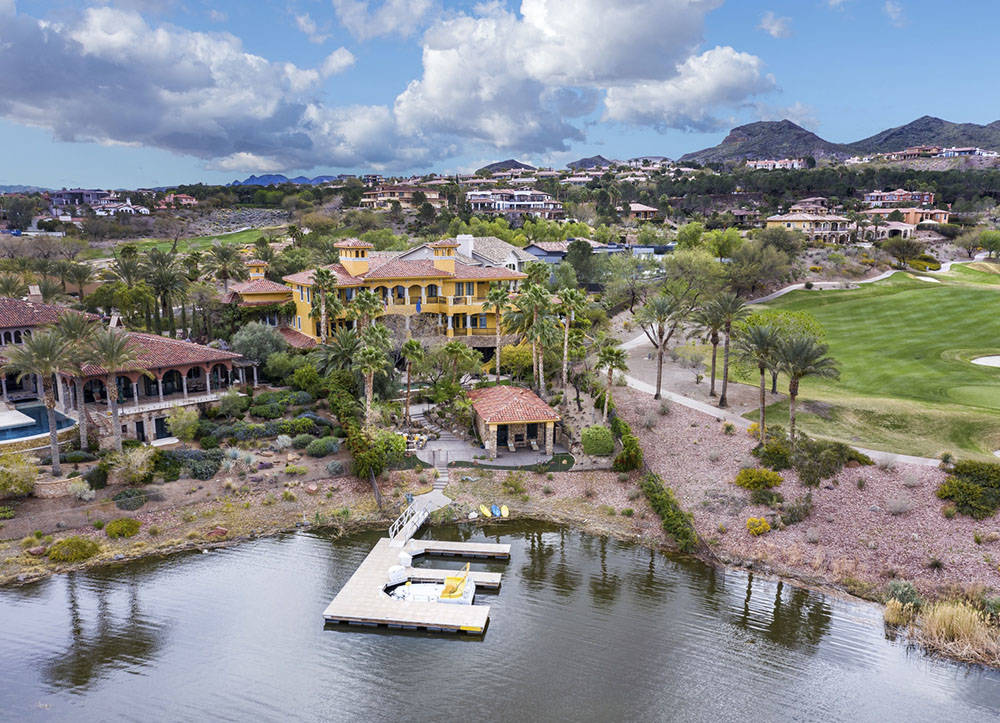 Elite Homes This 10,549-square-foot Mediterranean-style mansion at Lake Las Vegas has been list ...