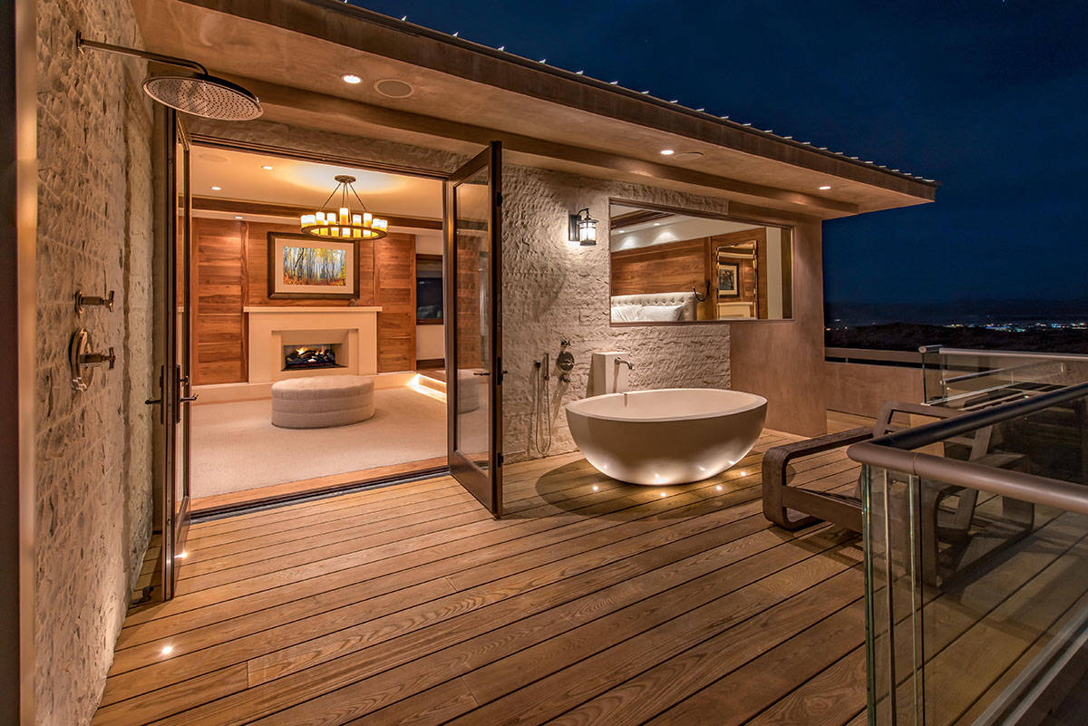 The master suite occupants can even take in mountain surroundings when using the private outdoo ...