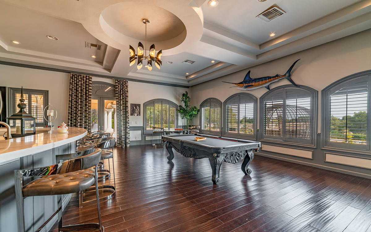 The main level of the home has a billiards room with extensive wet bar and sports media room. ( ...
