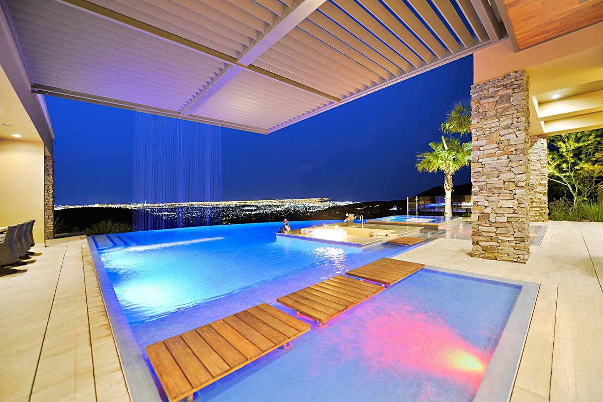 The MacDonald Highlands home has an infinity-edge pool and five-car garage and unobstructed vie ...