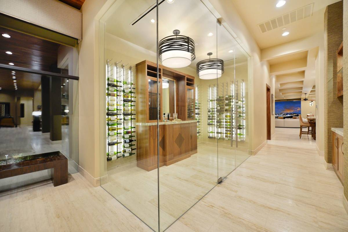 The luxury home has a lot of special spaces, including a wine cellar. The back of the home has ...