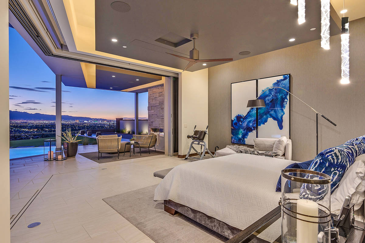 "The master bedroom has a ""disappearing corner"" that connects the room to the pool and spa area. ..."