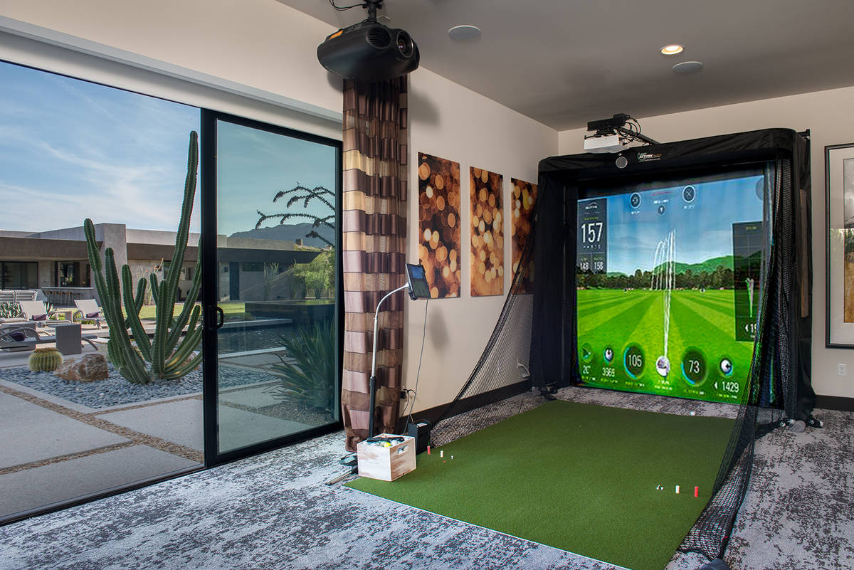The home has lots of entertainment features, including this virtual golf area. (Simply Vegas)