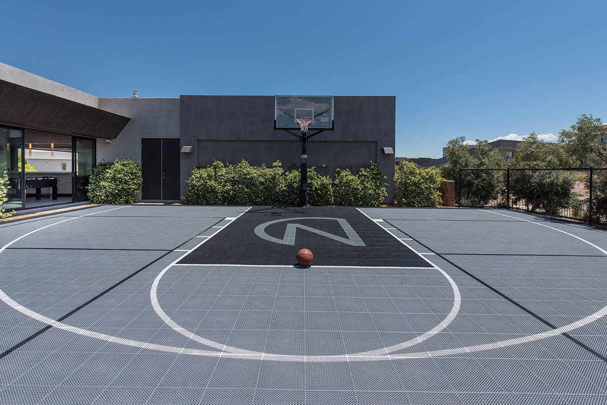 Las Vegas injury law attorney Farhan Naqvi built an outdoor basketball court for his home in Th ...