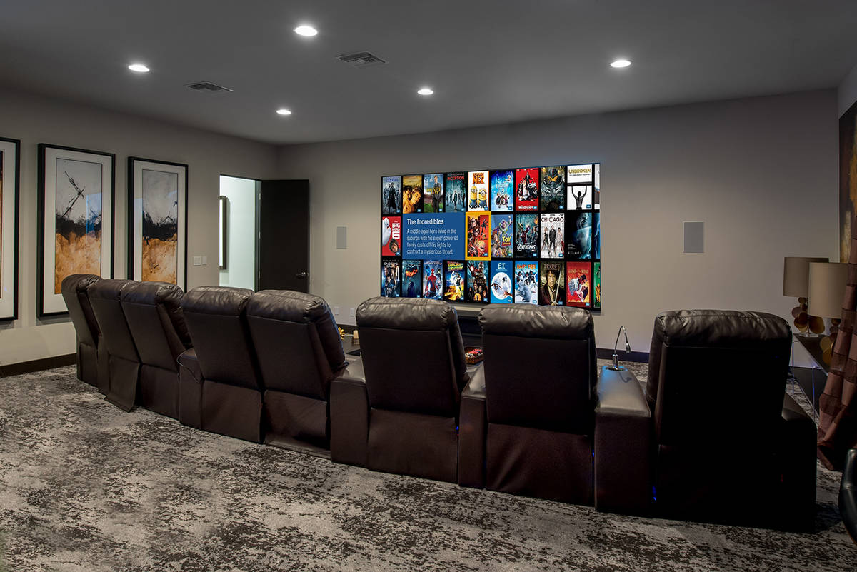 A large movie theater is on the main floor of the 7,000-square-foot main house. The home is in ...