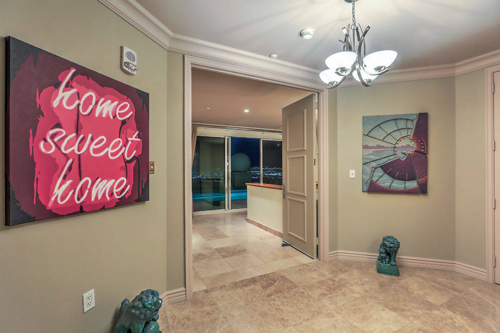 The upstairs entertainment level, which measures nearly 3,000 square feet, features a spacious ...