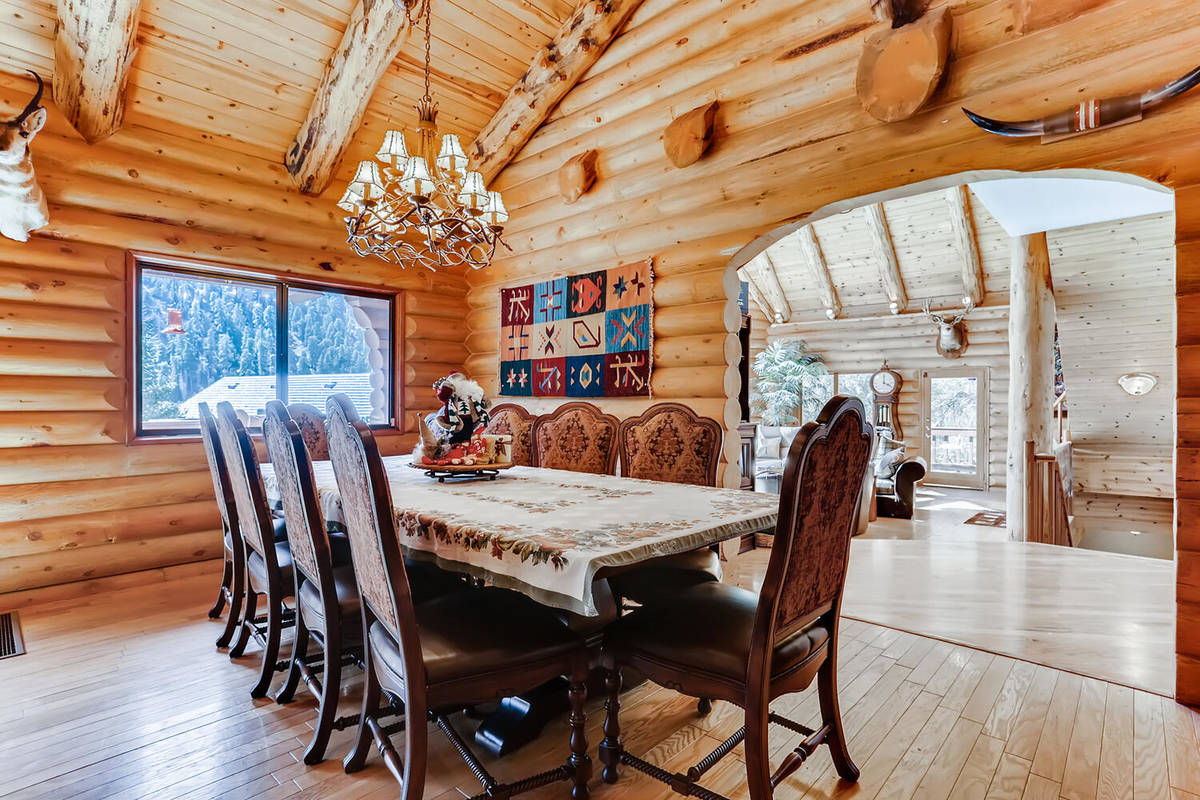 Mt. Charleston Realty The Mount Charleston cabin at 261 Kris Kringle Road has a large dining room.